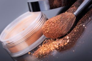 Makeup brush powder coated in crumbling face foundation