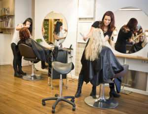 students working in salon